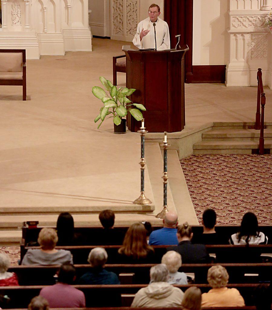 Fr. Mike Pucke explains the history of Maribel Trujillo Diaz's deportation during a Prayer of Thanksgiving at St. Julie Billiart Parish in Hamilton Tuesday, Sept. 25, 2018. (CT Photo/E.L. Hubbard)