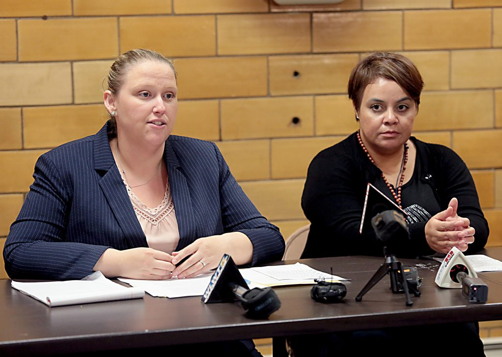 Maribel Trujillo Diaz, right, listens as one of her attorneys, Kathleen Kersh, speaks to the media after the Prayer of Thanksgiving at St. Julie Billiart Parish in Hamilton Tuesday, Sept. 25, 2018. (CT Photo/E.L. Hubbard)