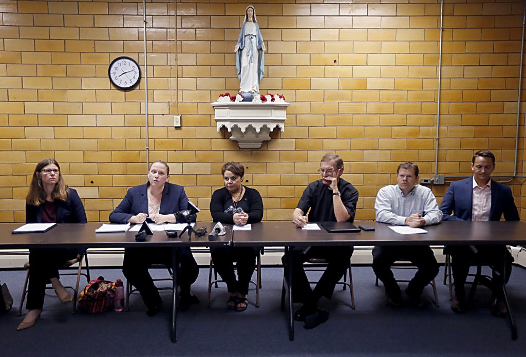 Left to right, Attorneys Emily Brown, Kathleen Kersh, Maribel Trujillo Diaz, Fr. Mike Pucke, Tony Stieritz, and Rev. Alan Dicken speak to the media after the Prayer of Thanksgiving at St. Julie Billiart Parish in Hamilton Tuesday, Sept. 25, 2018. (CT Photo/E.L. Hubbard)