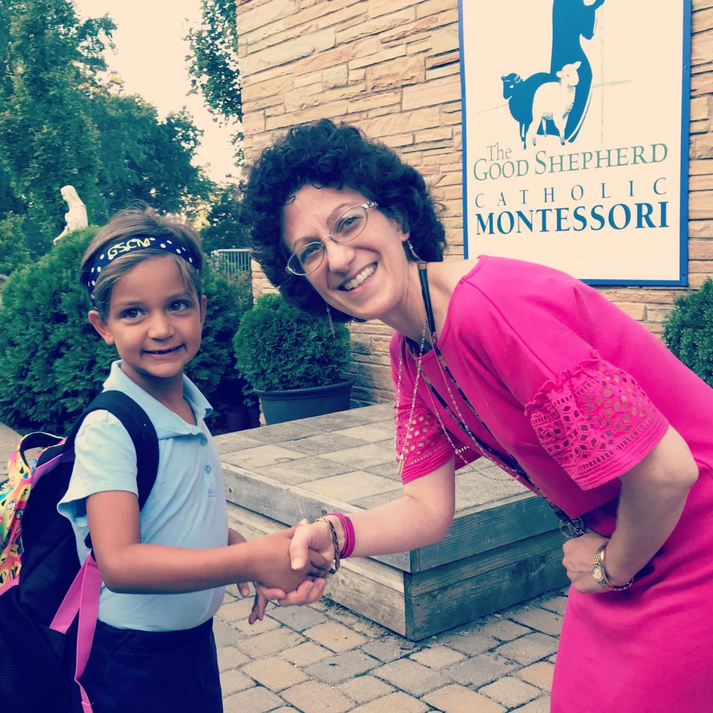 Principal Anne Marie Vega welcomes second grader Paisley Sanborn of Price Hill on the first day of school. (Courtesy Photo)