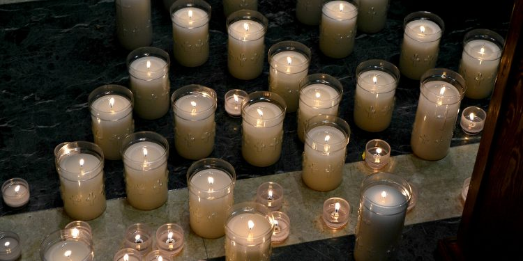 Many left a candle for petitions to St. Padre Pio. (CT Photo/Greg Hartman)