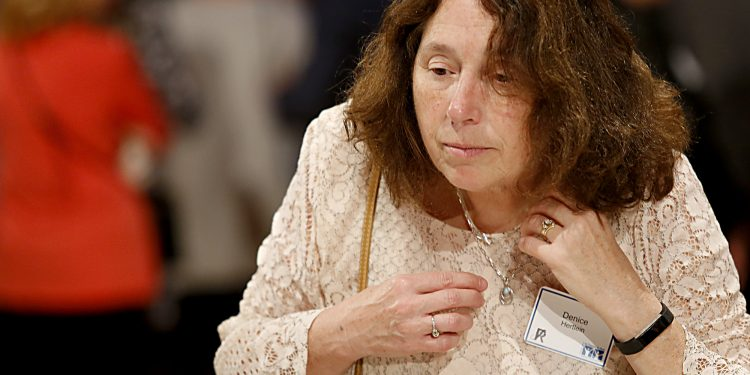 Denice Hertlein tries on a necklace during RetroFittings 2018, a St. Vincent de Paul fundraising event, at Music Hall in Cincinnati Thursday, Oct. 18, 2018. (CT Photo/E.L. Hubbard)