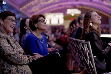 Shelly Maxwell, Jackie Hirt, and Holly Mazzocca watch the fashion show during RetroFittings 2018, a St. Vincent de Paul fundraising event, at Music Hall in Cincinnati Thursday, Oct. 18, 2018. (CT Photo/E.L. Hubbard)