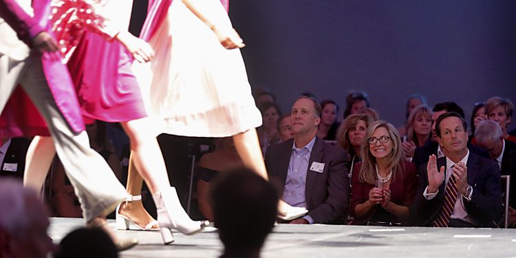 Patrons watch the fashion show during RetroFittings 2018, a St. Vincent de Paul fundraising event, at Music Hall in Cincinnati Thursday, Oct. 18, 2018. (CT Photo/E.L. Hubbard)
