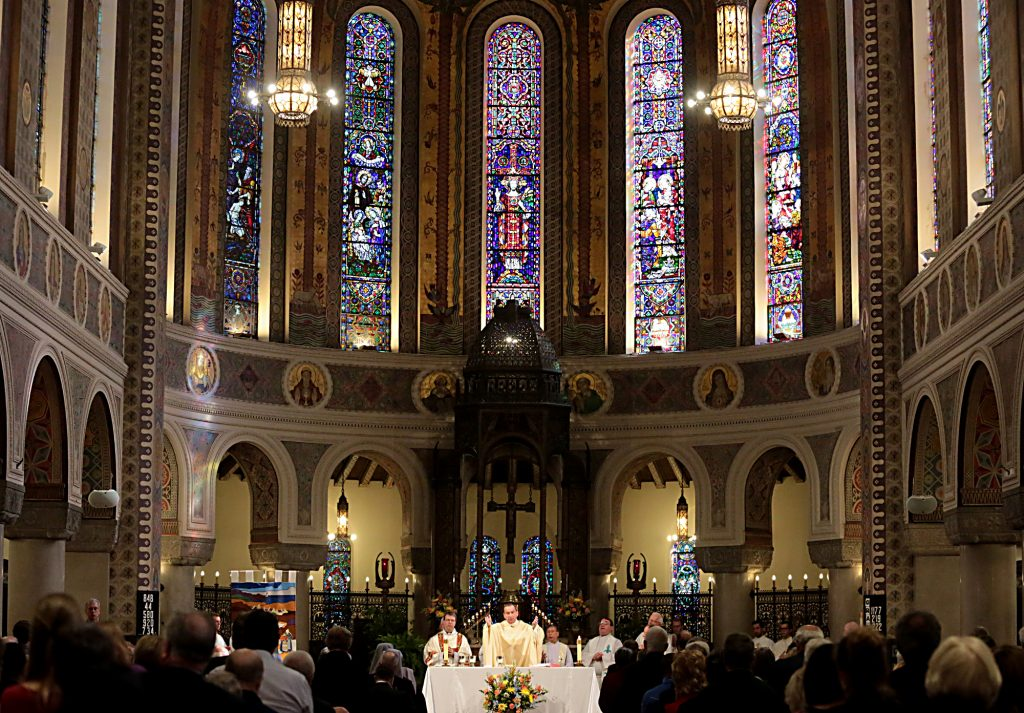 Archbishop Dennis Schnurr prepares the Holy Eucharist for the Mass of Thanksgiving for the 150th Anniversary of the Arrival of the Little Sisters of the Poor in Cincinnati at St. Monica-St. George Parish in Cincinnati Saturday, Oct. 20, 2018. (CT Photo/E.L. Hubbard)