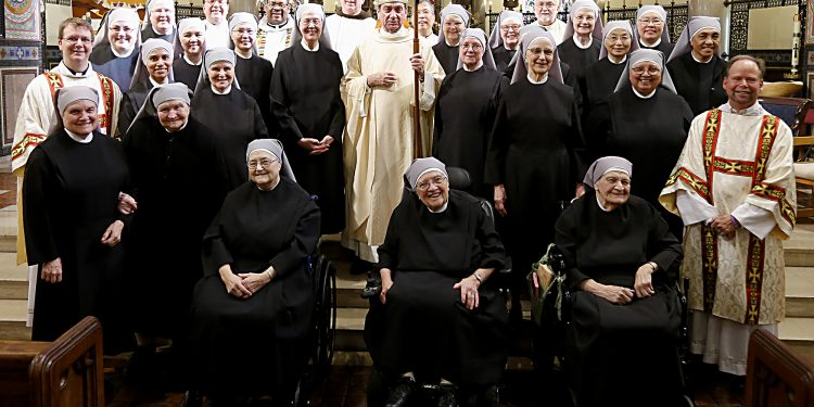 Archbishop Dennis Schnurr and Little Sisters of the Poor after the Mass of Thanksgiving for the 150th Anniversary of the Arrival of the Little Sisters of the Poor in Cincinnati at St. Monica-St. George Parish in Cincinnati Saturday, Oct. 20, 2018. (CT Photo/E.L. Hubbard)