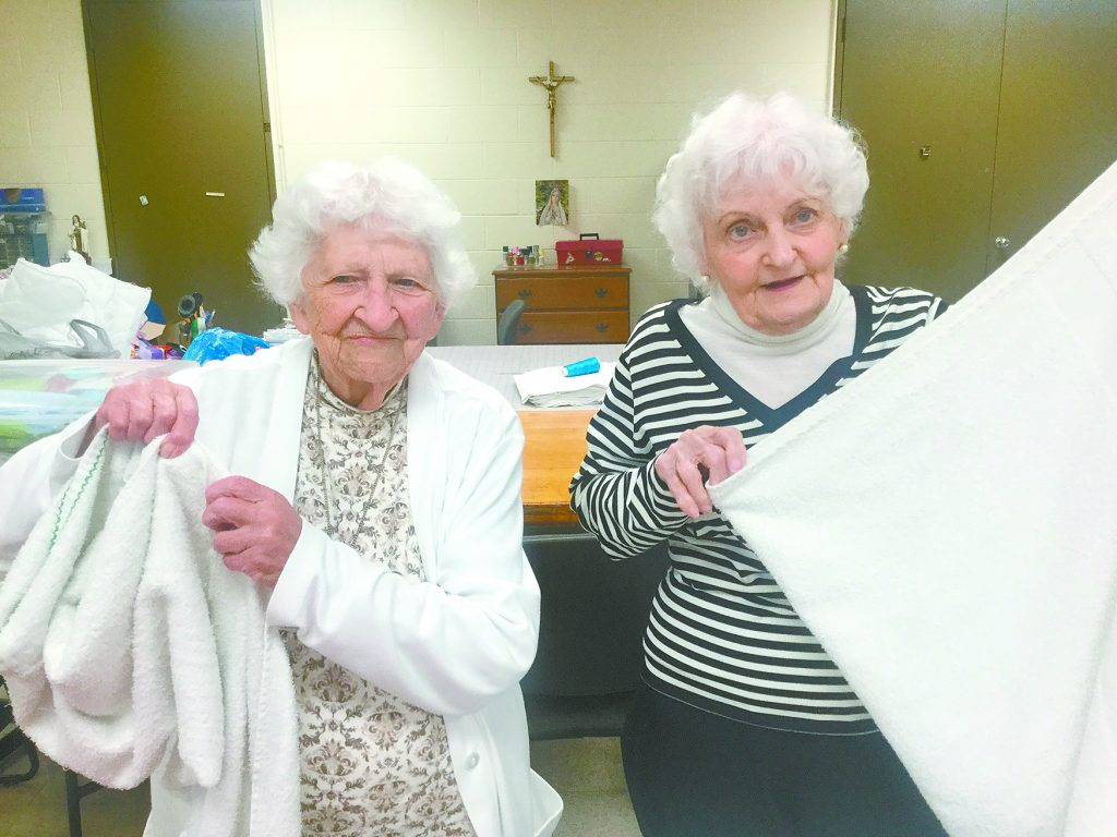 Residents Nancy, left, and Madeline, help fold laundry. (Courtesy Photo)