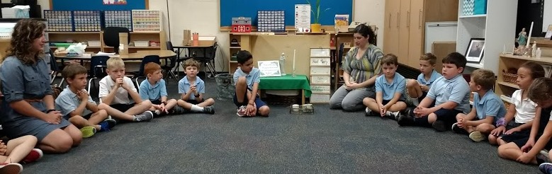 Students in the Lourdes Classroom begin the morning with prayer. (Courtesy Photo)