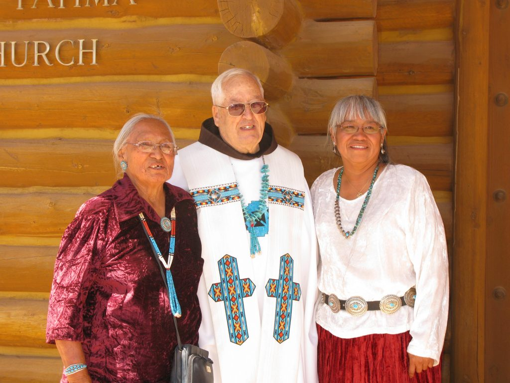 Franciscan Father Blaine Grein poses with parishioners in Chinle, Ariz., where he served from 1978-2012. (Courtesy Photo)