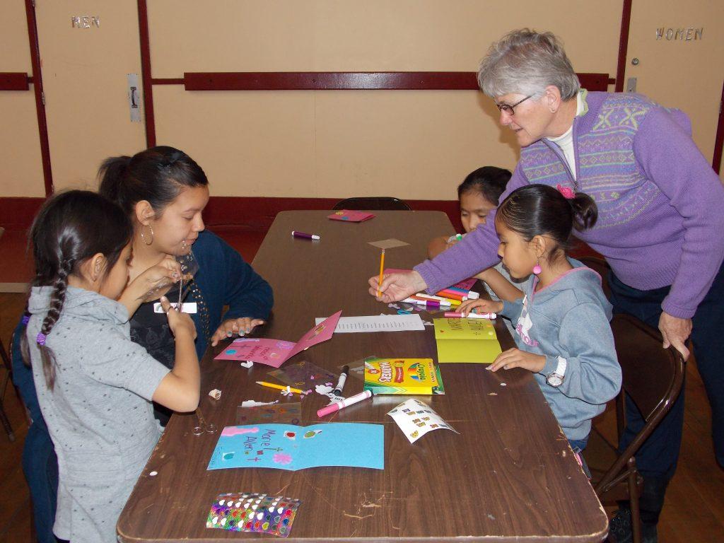 Sister Zoe Brenner helps children make cards for tribal elders. (Courtesy Photo)