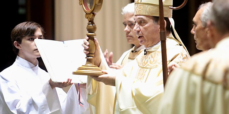 Holding a Relic, Archbishop Dennis Schnurr offers the Final Blessing during Mass and Veneration of the Relics of Saint Pio of Pietrelcine, O.F.M Cap, at Saint Peter in Chains Cathedral in Cincinnati Wednesday, Oct. 3, 2018. (CT Photo/E.L. Hubbard)