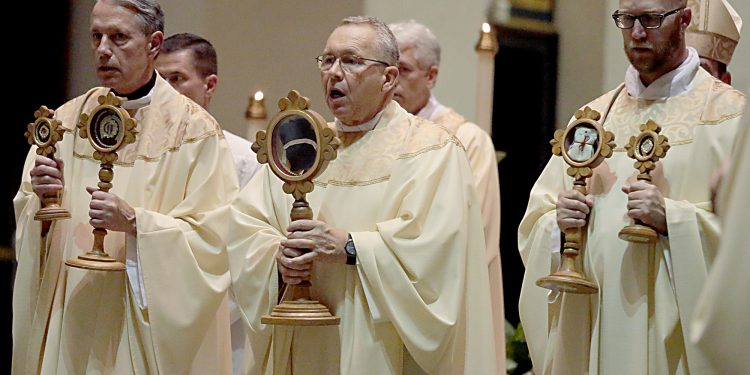 Fr. Raymond Larger, Fr. Jan Schmidt, and Fr. Kyle Schnippel carry the Relics during Mass and Veneration of the Relics of Saint Pio of Pietrelcine, O.F.M Cap, at Saint Peter in Chains Cathedral in Cincinnati Wednesday, Oct. 3, 2018. (CT Photo/E.L. Hubbard)