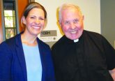 Cheri Champagne, Catholic coordinator at Our Lady Queen of Peace Parish on Wright-Patterson AFB, poses with Father Donald Moss, pastor. (Courtesy Photo)
