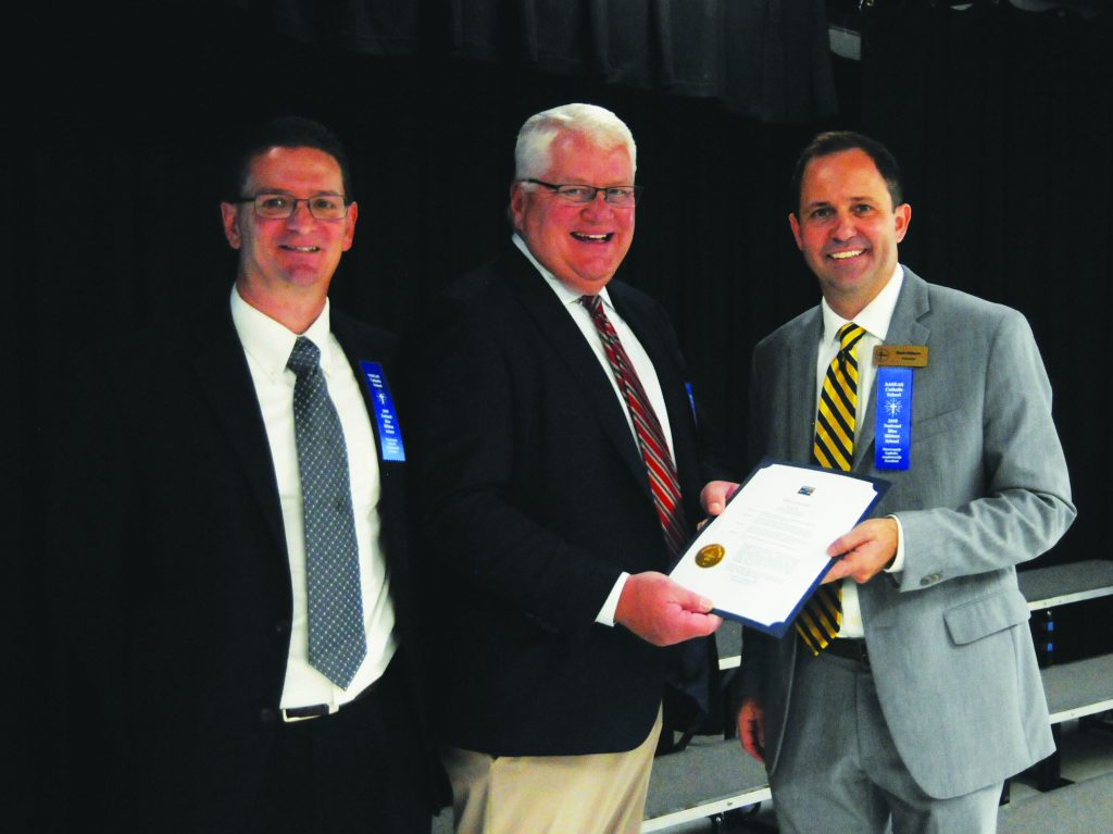 Milford Mayor Fred Albrecht presents a proclamation recognizing St. Andrew-St. Elizabeth Ann Seton Catholic School's designation as a Blue Ribbon School of Excellence to Principal Mark Wilburn and Assistant Principal Nick Grieco( on Friday, Oct. 12. (CT Photo/David A. Moodie)