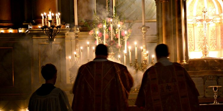 The night is advanced, the day is at hand. Let us then throw off the works of darkness [and] put on the armor of light Romans 13:12 Rorate Mass Old St Mary (CT Photo/Greg Hartman)