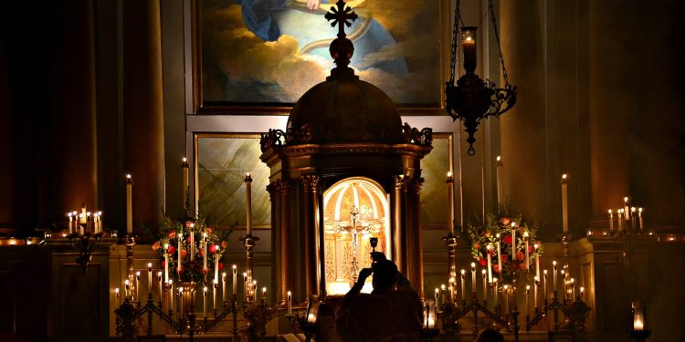 """Jesus spoke to them again, saying, """"I am the light of the world. Whoever follows me will not walk in darkness, but will have the light of life.""""f John 8:12 Rorate Mass Old St Mary (CT Photo/Greg Hartman)"""