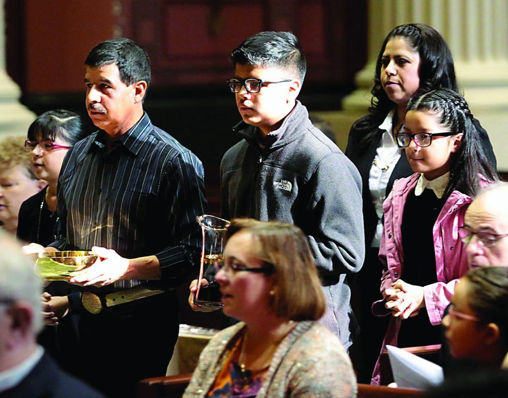 The Davila-Lopez family carries the Gifts during the Misa de Graduacion en Catequesis Camina Con Cristo at Saint Peter in Chains Cathedral in Cincinnati Saturday, Nov. 3, 2018. (CT Photo/E.L. Hubbard)