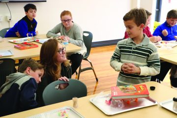 Nativity teacher Olivia Wolber oversees students working in the STEAM lab. (Courtesy Photo)