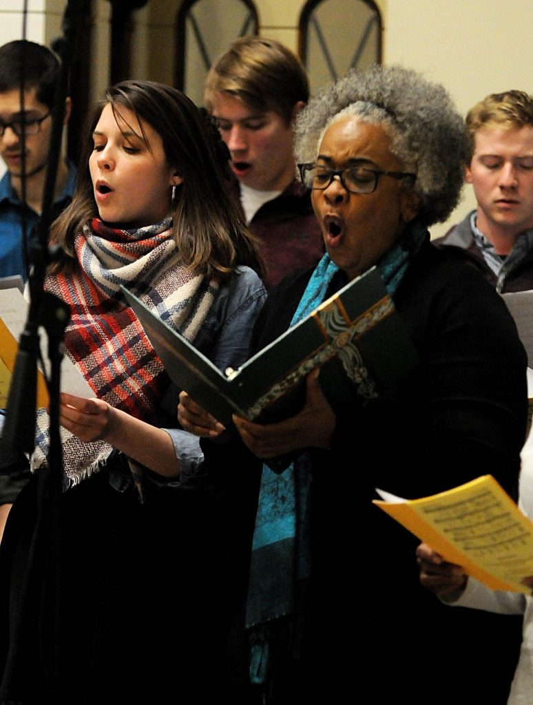 """University of Dayton Senior Megan Earley(cq) and Church of the Resurrection choir member Rita Winters(cq) sing the prelude prior to UD's """"Mass In Celebration of Black History Month,"""" on Sunday, Feb. 10. (CT Photo/David Moodie)"""