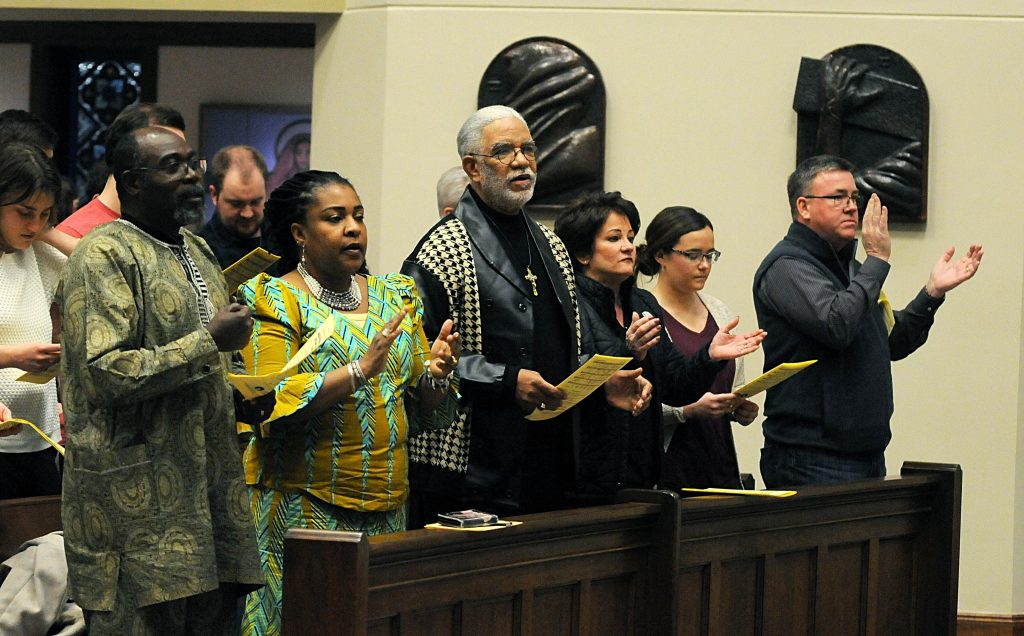"""Members of the congregation sing the """"Gathering Hymn"""" during the Unversity of Dayton's """"Mass in Celebration of Black History Month"""" in the Chapel of the Immaculate Conception on Sunday, Feb. 10. (CT Photo/David Moodie)"""