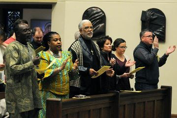 "Members of the congregation sing the ""Gathering Hymn"" during the Unversity of Dayton's ""Mass in Celebration of Black History Month"" in the Chapel of the Immaculate Conception on Sunday, Feb. 10. (CT Photo/David Moodie)"