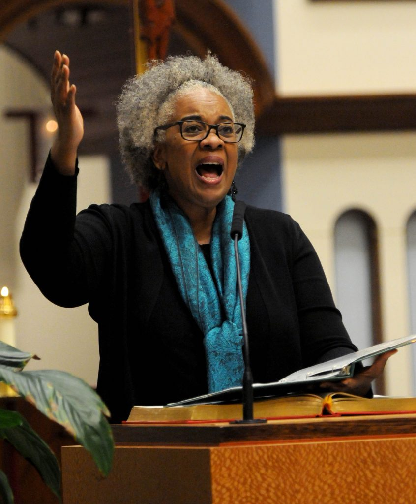 Rita Winters(cq) leads the congregation in the Responsorial Psalm during the University of Dayton's Mass In Celebration of Black History Month on Sunday, Feb. 10. (CT Photo/David Moodie)