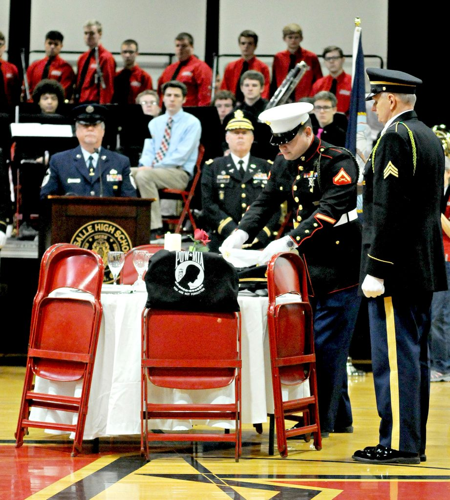 """Members of the honor guard for the Green Twp. Veterans of Foreign Wars Post 10380 present """"The Missing Man"""" Ceremony during La Salle High School's 5th Annual Veteran Appreciation Day on Tuesday, Feb. 12. The ceremony honors armed service and civilian personel who are listed as Missing In Action while serving in or with the United States military.(CT Photo/David Moodie)"""