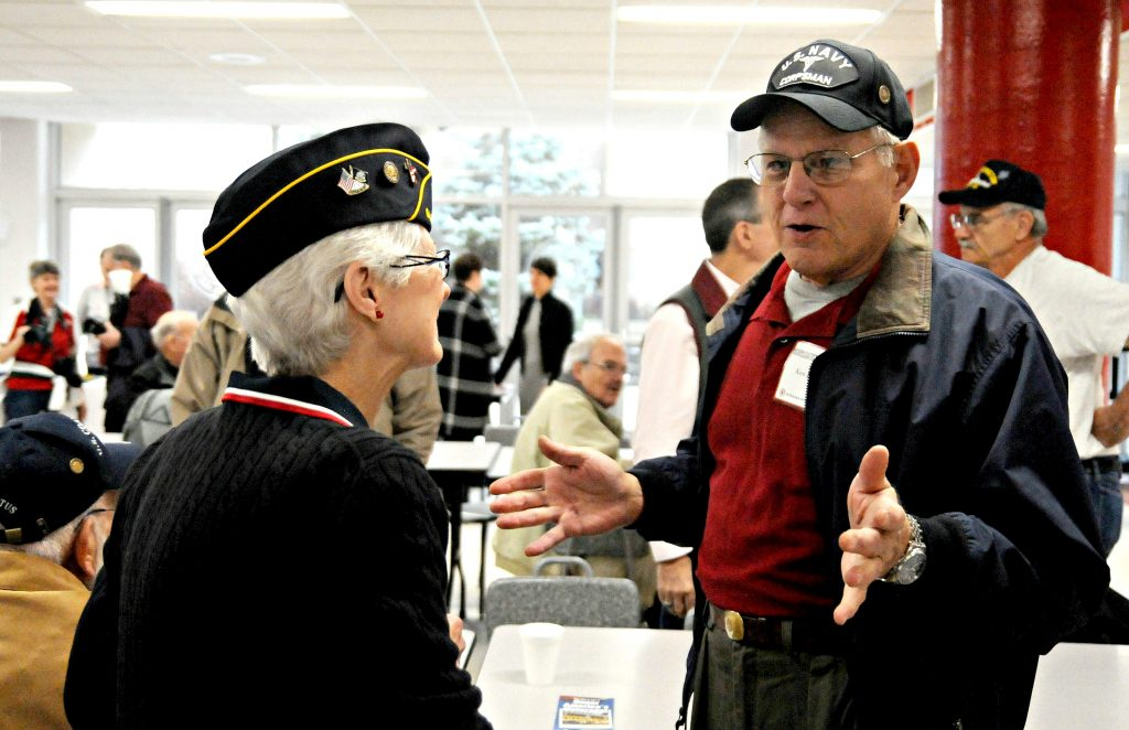 Navy veterans Peg Albert(cq) and Ken Baier(cq) talk in the La Salle High School cafeteria prior to the school's 5th Annual Veteran Appreciation Day program on Tuesday, Feb. 12. Albert was a nurse while Baier served as a corpsman. Baier is also a member of La Salle's first graduating class. (CT Photo/David Moodie)