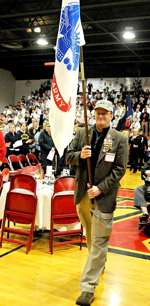 Retired Army Colonel Steve Koenig carries the Army flag during the opening processional of La Salle High School's 5th Annual Veteran Appreciation Day on Tuesday, Feb. 12. Veterans from the greater Cincinnati area were recognized by the school's student body and staff for their service to United States of America. (CT Photo/David Moodie)
