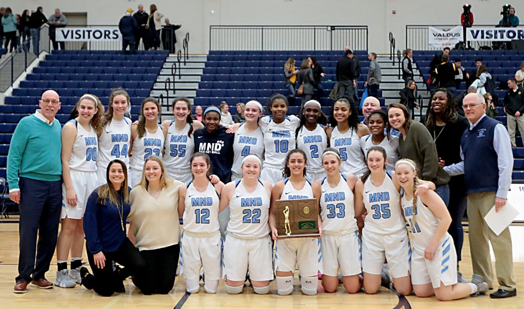 Mount Notre Dame holds their trophy after defeating Centerville in their Division I regional final at Trent Arena in Kettering Saturday, Mar. 9, 2019. (CT Photo/ EL Hubbard)