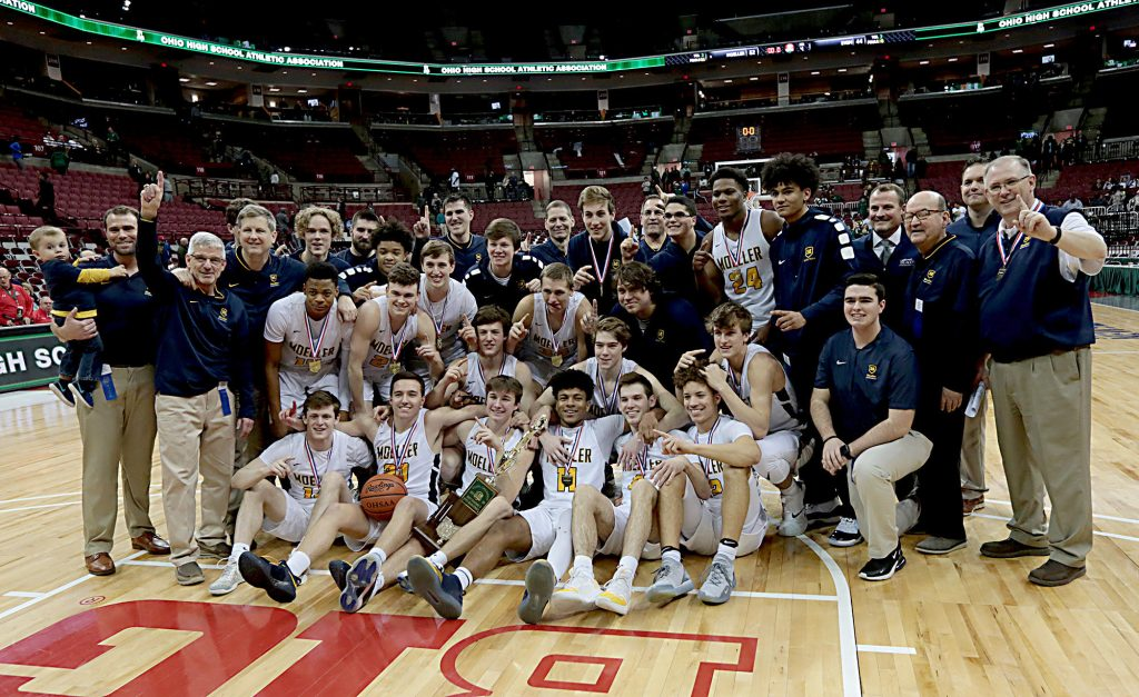 Moeller poses with the state championship trophy after defeating St. Vincent-St. Mary at the Schottenstein Center in Columbus Saturday, March 23, 2019. (CT Photo/EL Hubbard)