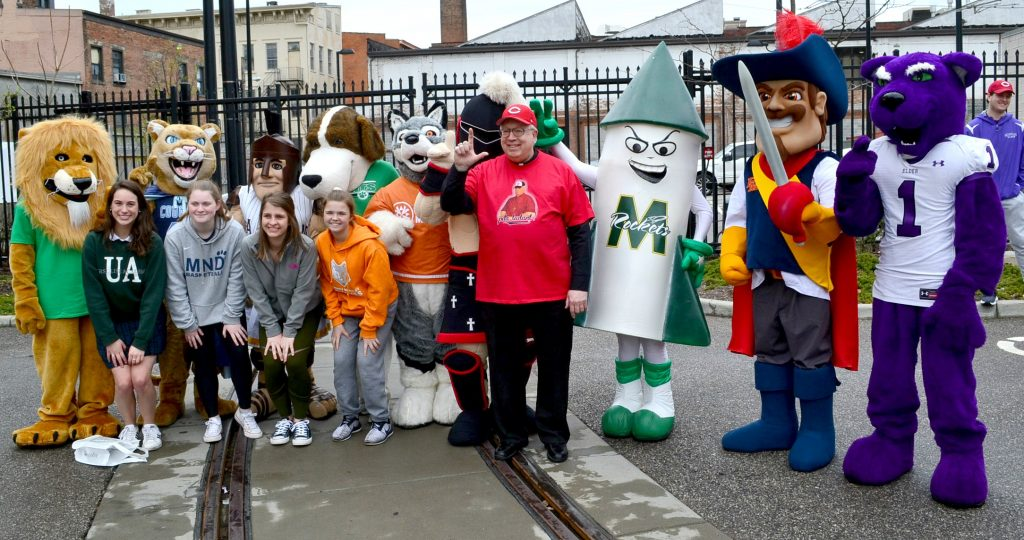 Mascots from various Archdiocese of Cincinnati Catholic High School pose for a picture with Bishop Joseph Binzer before the 2019 Findlay Market Opening Day Parade. (CT Photo/Greg Hartman)