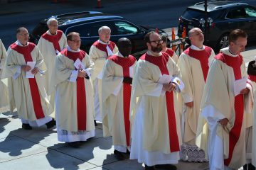 Priest throughout the Archdiocese of Cincinnati process during Diaconate Ordination. (CT Photo/Greg Hartman)