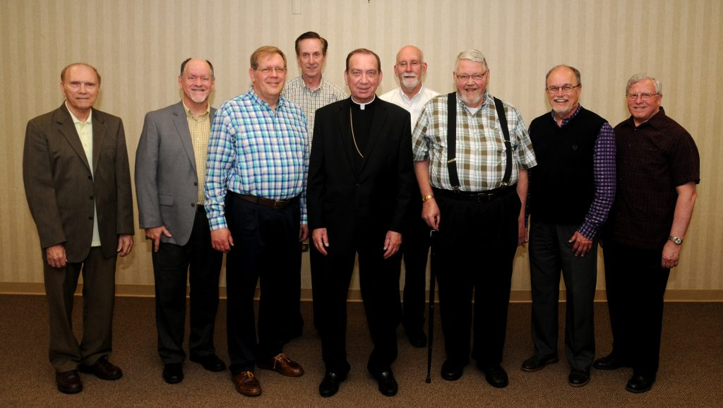 Archbishop Dennis M. Schnurr, center, stands with members of the Ordination Class of 1979, during the Archdiocese of Cincinnati's annual Ordination Anniversasry Dinner at the Bergamo Center in Beavercreek, Ohio on Monday, May 6. Members of the class include: Front L-R Fathers Terry Schneider, Jerry Gardner, Jeff Kemper. Marc Sherlock, Jim Schutte, and Dave Lemkuhl. Back L-R Fathers Larry Tensi and Len Wenke. (CT Photo/David A. Moodie)