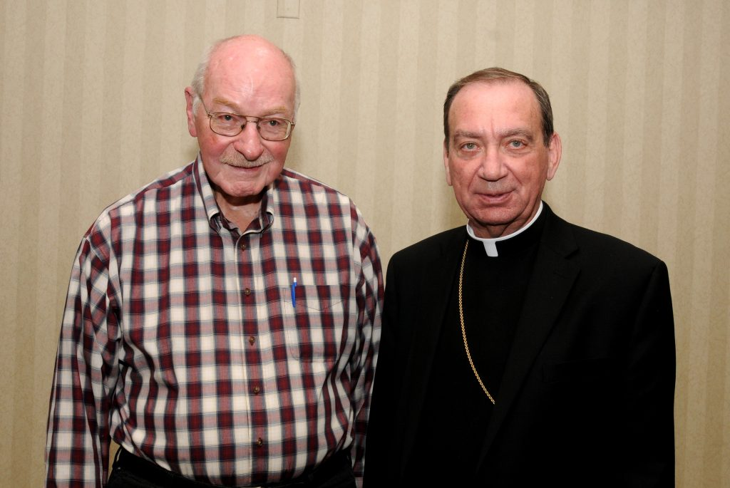 Archbishop Dennis M. Schnurr, right, stands with Ordination Class of 1959 member Father Eugene F. Vonderhaar(, left, during the Archdiocese of Cincinnati's annual Ordination Anniverssary Dinner at the Bergamo Center in Beavercreek, Ohio on Monday, May 6. (CT Photo/David A. Moodie)