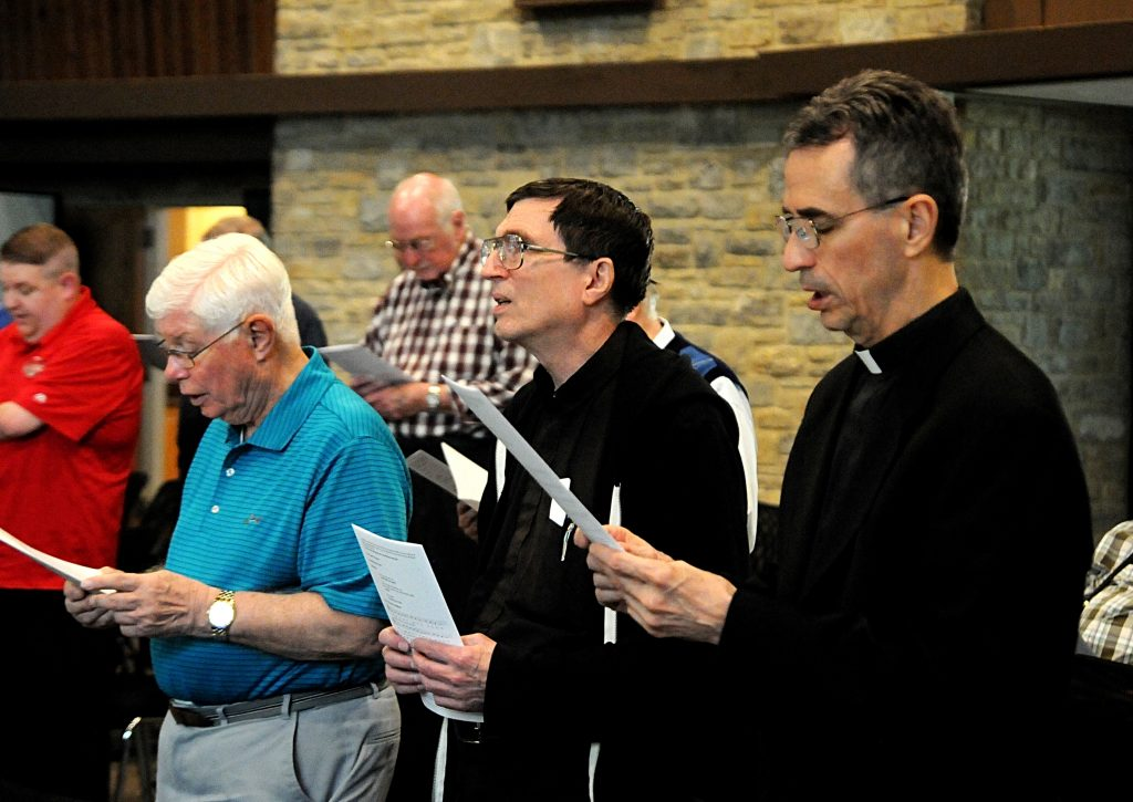 Fathers Ken Baker, Joe Kindel and Tom Nevels sing the opening hymn during vespers prior to the Archdiocese of Cincinnati's Ordination Anniversary Dinner at the Bergamo Center in Beavercreek, Ohio on Monday, May 6. Priests from the ordination classes of 1959, '69, '79 and '94 were recognized for their years of service during the annual celebration, which also featured a dinner. (CT Photo/David A. Moodie)