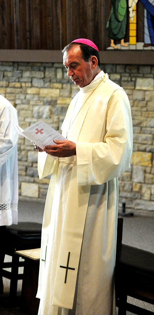 Archbishop Dennis M. Schnurr leads the congregation in vespers prior to the Archdiocese of Cincinnati's Ordination Annivesary Dinner at the Bergamo Center in Beavercreek, Ohio on Monday, May 6. This year's event recognized the service of the Ordination Classes of 1959, '69, '79 and '94. (CT Photo/David A. Moodie)