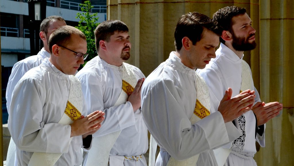 Front Row, Deacon Andrew Hess, Deacon Ambrose Dobrozsi; 2nd Row: Deacon Jeff Stegbauer, Deacon Mark Bredestege entering the Cathedral of St. Peter in Chains. (CT Photo/Greg Hartman)