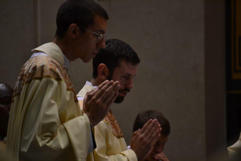 Father Christian Cone-Lombarte & Father Ambrose Dobrozsi during the Eucharistic Prayer. (CT Photo/Greg Hartman)