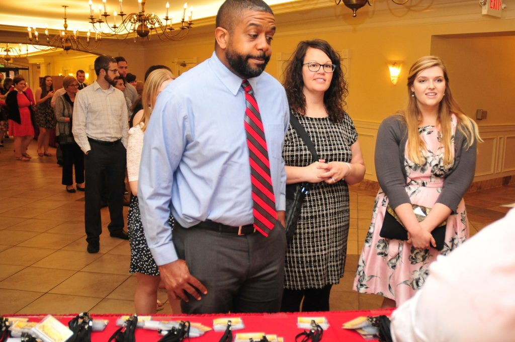 Eric Ramsey, Carroll HS, Lara Ramsey CHS, Mary Kate Caserta CHS, all get checked into the dinner. (CT Photo/Jeff Unroe)