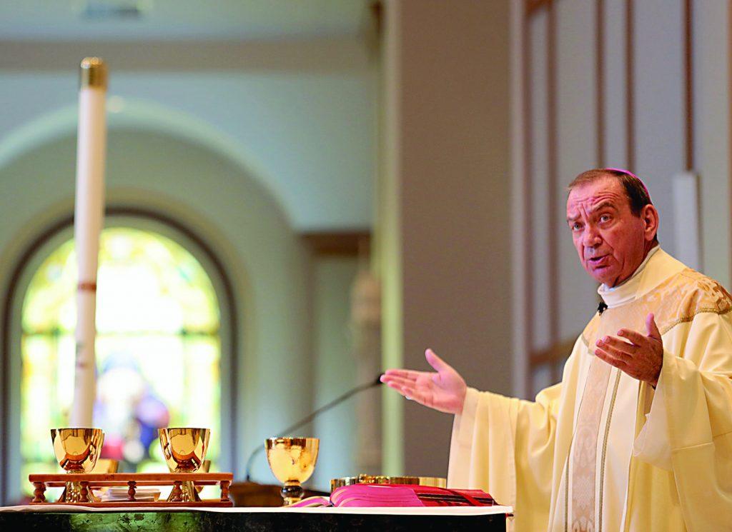 Archbishop Dennis Schnurr prepares the Holy Eucharist during the dedication of St. John the Baptist Church in Harrison Saturday, June 1, 2019. (CT Photo/E.L. Hubbard)