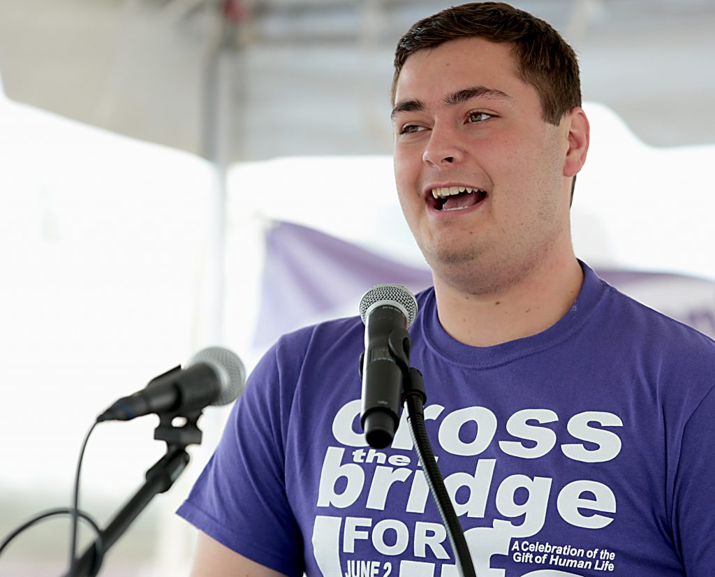Carson Rayhill, with Students for Life at Xavier University, speaks during the Cross the Bridge for Life in Newport, Ky. Sunday, June 2, 2019. (CT Photo/E.L. Hubbard)