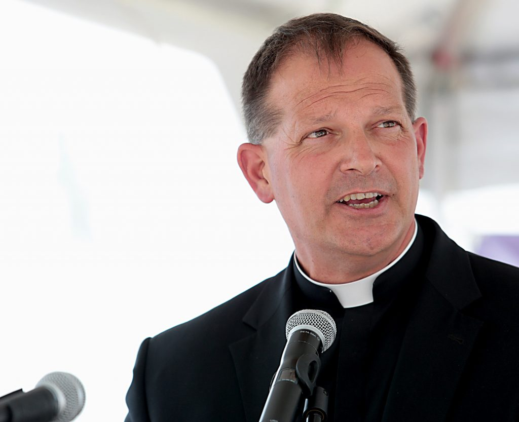 Fr. Anthony Brausch, rector of Mount Saint Mary's Seminary, speaks during the Cross the Bridge for Life in Newport, Ky. Sunday, June 2, 2019. (CT Photo/E.L. Hubbard)