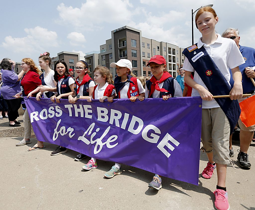 American Heritage Girls carry the banner during the Cross the Bridge for Life in Newport, Ky. Sunday, June 2, 2019. (CT Photo/E.L. Hubbard)