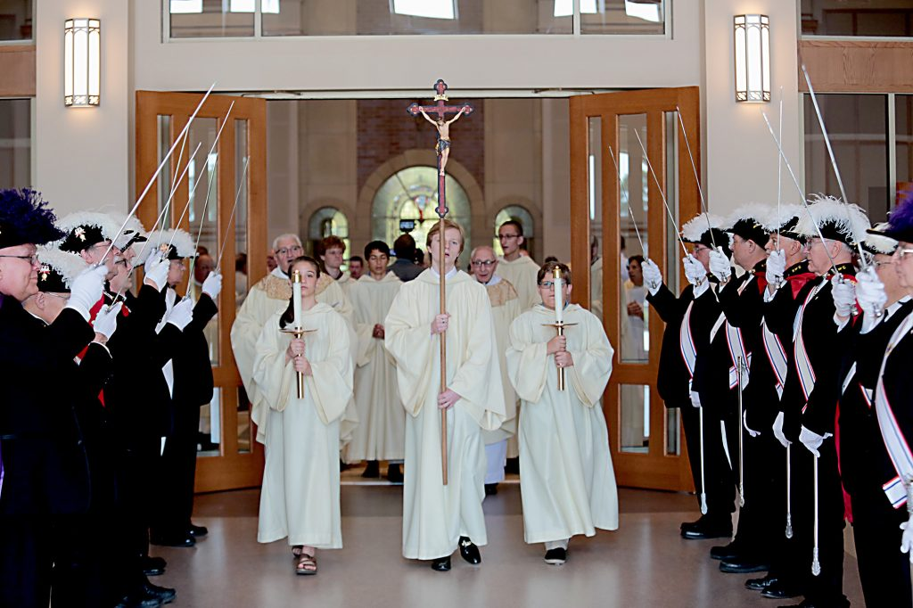 The closing procession passes the Knights of Columbus Honor Guard during the dedication of St. John the Baptist Church in Harrison Saturday, June 1, 2019. (CT Photo/E.L. Hubbard)