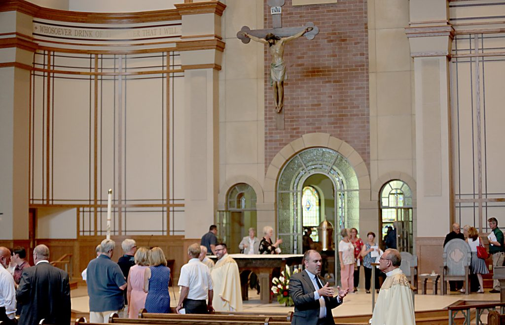 People linger in the new church after the dedication of St. John the Baptist Church in Harrison Saturday, June 1, 2019. (CT Photo/E.L. Hubbard)