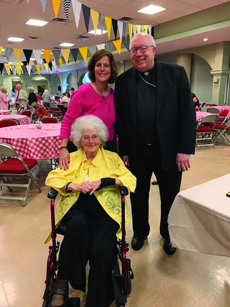 Bishop Joseph Binzer poses for a picture with St. Antoninus parishioners Karen Cromer and her mother Jean Boehme. (Courtesy Photo)
