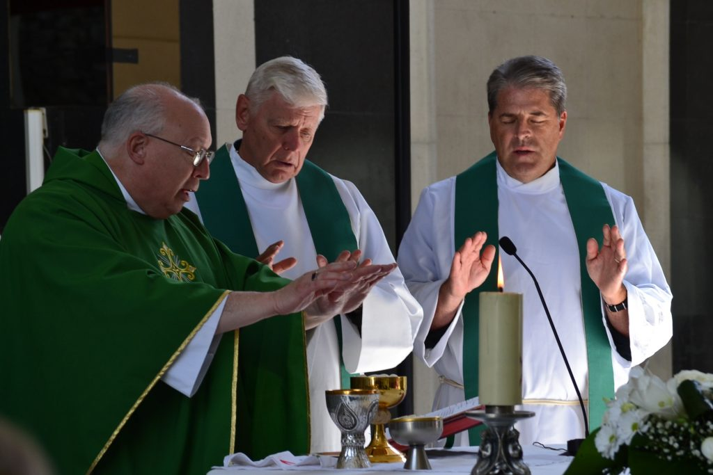 Father David Brinkmoeller concelebrates Mass at Our Lady of Merixtell in Merixtell, Andorra. left to right, Father Thomas Wray, Bishop Joseph Binzer, Father David Brinkmoeller (CT Photo/Greg Hartman)