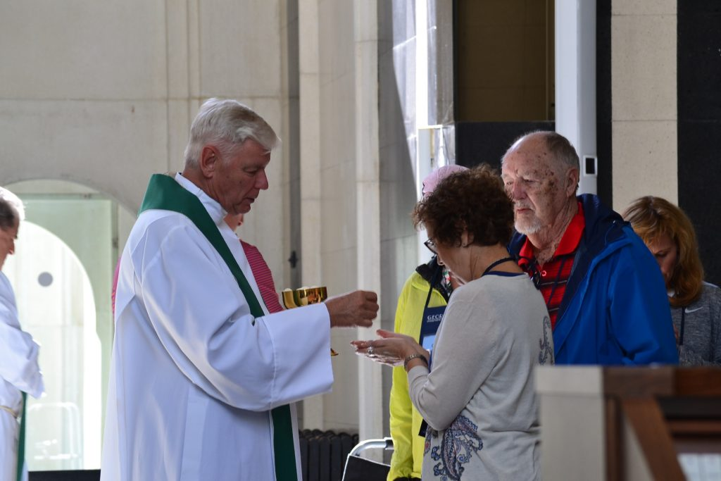 Father David Brinkmoeller distributes Communion at Mass at Our Lady of Merixtell in Merixtell, Andorra. (CT Photo/Greg Hartman)