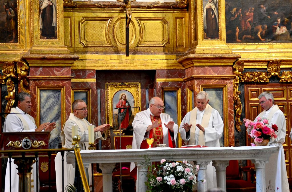 Father David Brinkmoeller concelebrates Mass at the tomb of St. Teresa of Avila in Alba de Tomres, Spain on the Marian Pilgramage in 2017.. From left to right, Father Tom Wray, Father Jan Schmidt, Bishop Joseph Binzer, Father David Brinkmoeller, and Father Tim Ralston. (CT Photo/Greg Hartman)